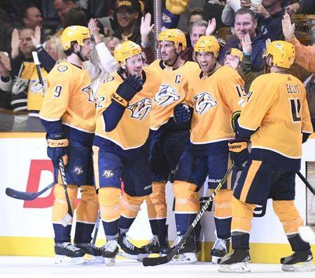 Nov 19, 2018; Nashville, TN, USA; Nashville Predators center Ryan Johansen (92) and his teammates celebrate his goal during the second period at Bridgestone Arena. Mandatory Credit: Steve Roberts-USA TODAY Sports