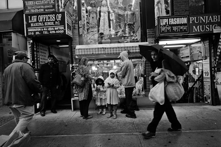<p>Bengali and Indian retail stores stores on 74th Street in Jackson Heights, Queens, N.Y., a central shopping district where people from all over New York C come to shop. (Photo: Yunghi Kim/Contact Press Images) </p>