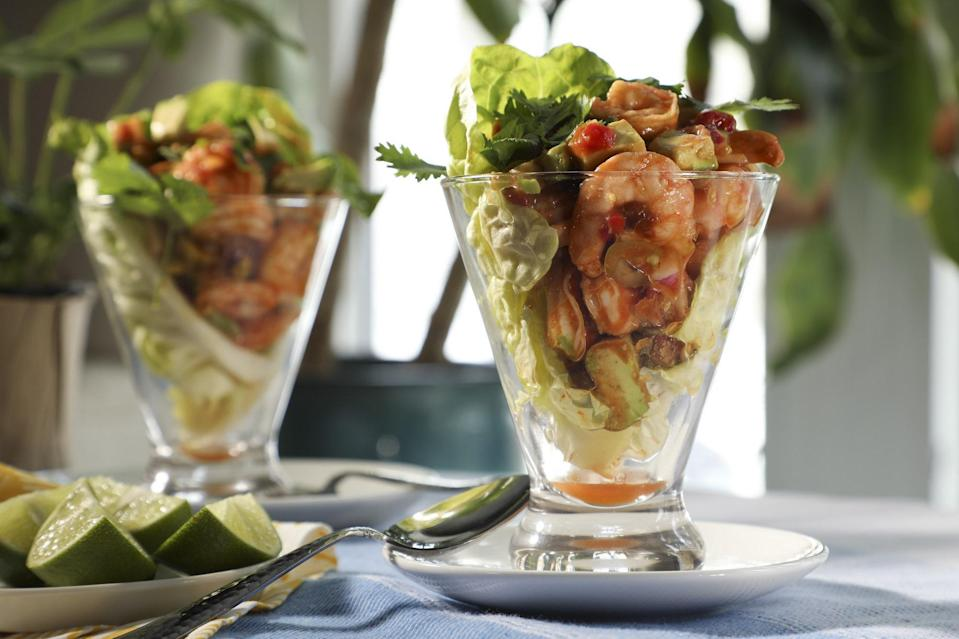 """<p>Shrimp cocktail is one of those <a href=""""https://www.thedailymeal.com/cook/best-retro-recipes-gallery?referrer=yahoo&category=beauty_food&include_utm=1&utm_medium=referral&utm_source=yahoo&utm_campaign=feed"""" rel=""""nofollow noopener"""" target=""""_blank"""" data-ylk=""""slk:retro recipes that never goes out of style"""" class=""""link rapid-noclick-resp"""">retro recipes that never goes out of style</a>. In this twist on a classic, shrimp is served with avocado and lime in tall glasses for a party-ready appetizer or side. Although this recipe calls for you to cook shrimp, you can very easily use precooked shrimp.</p> <p><a href=""""https://www.thedailymeal.com/shrimp-cocktail-salad-recipe?referrer=yahoo&category=beauty_food&include_utm=1&utm_medium=referral&utm_source=yahoo&utm_campaign=feed"""" rel=""""nofollow noopener"""" target=""""_blank"""" data-ylk=""""slk:For the Shrimp Cocktail Salad recipe, click here."""" class=""""link rapid-noclick-resp"""">For the Shrimp Cocktail Salad recipe, click here.</a></p>"""