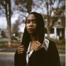 """In this photo made with a medium format film camera, Larrecsa Cox, 39, stands for a portrait in Huntington, W.Va., Thursday, March 18, 2021. Cox, a paramedic, leads the Quick Response Team that within days visits everyone who overdoses to try to pull them back from the brink. """"You're not in trouble,"""" she says, gives them the overdose reversal medication naloxone and offers help navigating their way to recovery. Huntington was once ground-zero for this epidemic. It was a hard-fought battle, but it worked. The county's overdose rate plummeted. They wrestled down an HIV crisis. Then the pandemic arrived undid much of their effort. """"I can't believe we've lost all these people,"""" said Cox. """"But sometimes, you just have to focus on the living."""" (AP Photo/David Goldman)"""