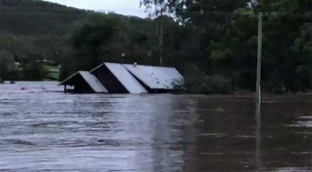 The house broke free of its bearings moments after the family was rescued. Source: ABC