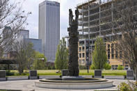 A sculpture commemorating the Tulsa Race Massacre stands in John Hope Franklin Reconciliation Park in Tulsa, Okla., on Wednesday, April 14, 2021, with new construction in the background. (AP Photo/Sue Ogrocki)