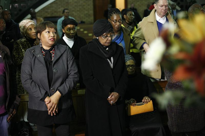 Zindzi Mandela, left and Winnie Mandela, center, participate in a prayer service for ailing former South African President Nelson Mandela at the Houghton Methodist Church in Johannesburg, South Africa, Friday July 5, 2013. Mandela remains in a critical condition at the Medi-Clinic Heart Hospital in Pretoria . (AP Photo/Jerome Delay)