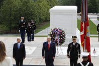 President Donald Trump stands with Vice President Mike Pence and Gen Omar Jones, Commanding General at Joint Force Headquarters, National Capital Region and United States Army Military District of Washington, at the Tomb of the Unknown Soldier in Arlington National Cemetery, in honor of Memorial Day, Monday, May 25, 2020, in Arlington, Va. (AP Photo/Alex Brandon)
