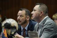 Arizona House Majority Leader Ben Toma, R-Peoria, right, watches the voting board along with Rep. Jeff Weninger, R-Chandler, during a vote on the Arizona budget Thursday, June 24, 2021, in Phoenix. (AP Photo/Ross D. Franklin)