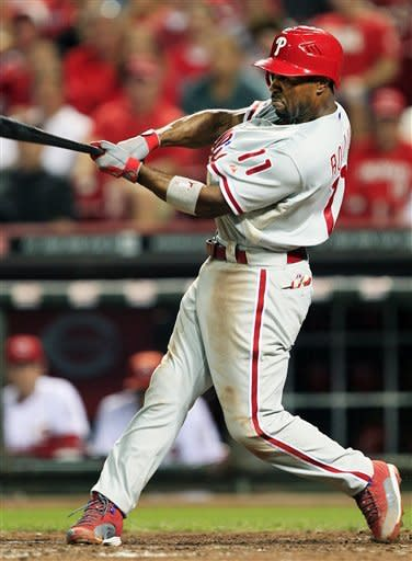 Philadelphia Phillies' Jimmy Rollins hits a double off Cincinnati Reds starting pitcher Mat Latos in the fifth inning of a baseball game, Tuesday, Sept. 4, 2012, in Cincinnati. The double was the 2,000th career hit for Rollins. (AP Photo/Al Behrman)