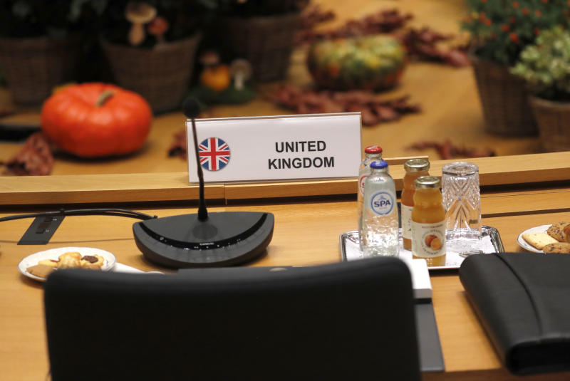An empty chair for the British delegation during a round table meeting at EU summit in Brussels, Friday, Oct. 18, 2019. After agreeing on terms for a new Brexit deal, European Union leaders are meeting again to discuss other thorny issues including the bloc's budget and climate change. (AP Photo/Frank Augstein)