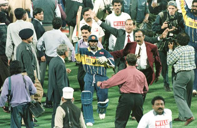 17 March 1996:  Aravinda De Silva raises his bat as he comes off the field after leading Sri Lanka to victory in the Cricket World Cup Final between Australia and Sri Lanka played at the Gaddafi stadium in Lahore. Mandatory Credit: John Parkin/ALLSPORT