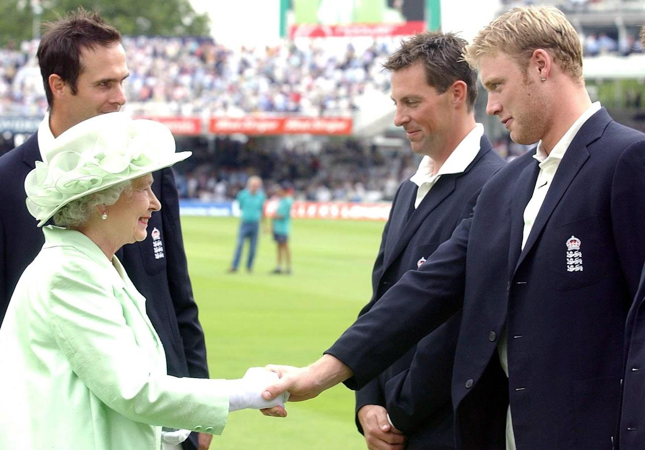 LONDON, UNITED KINGDOM - JULY 22:  Britain's Queen Elizabeth II Meets With England's Andrew Flintoff As Marcus Trescothick (second Right) And Michael Vaughan Look On During The First Day Of The Npower Test Against The West Indies At Lords  Cricket Ground In London  (Photo by Tim Graham Picture Library/Getty Images)