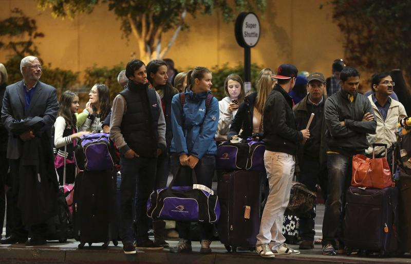 Travelers wait for transportation at Los Angeles International Airport