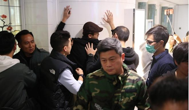 A man is searched by plain-clothes police in Harbour City. Photo: Winson Wong