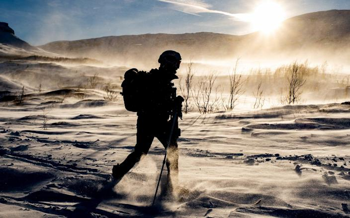 A Royal Marine of the Surveillance and Reconnaissance Squadron during Winter Deployment 21 in the Arctic. - PO Phot Si Ethell/Royal Navy