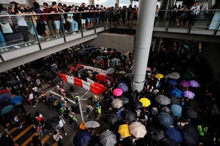 FILE PHOTO: Barriers set up by anti-extradition bill protesters are seen during a protest outside the airport in Hong Kong