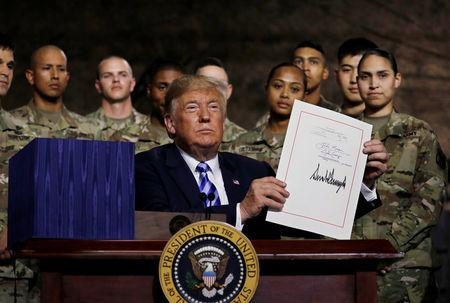 Trump signs $717bn annual defence policy bill into law
