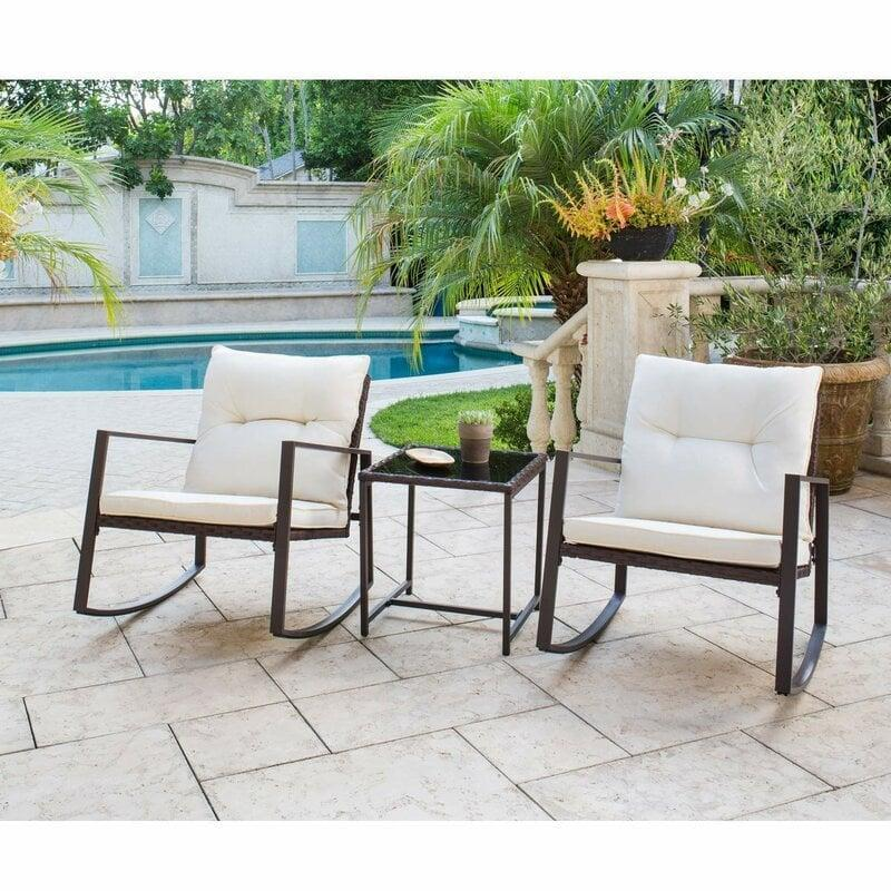 <p>Sit back and relax in this <span>Kinzie Outdoor 3 Piece Bistro Set With Cushions</span> ($235).</p>