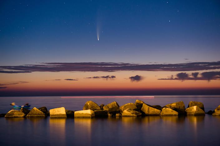Comet Neowise shines at sunset above the Port of Molfetta in Molfetta on July 11, 2020. / Credit: Davide Pischettola/NurPhoto via Getty Images