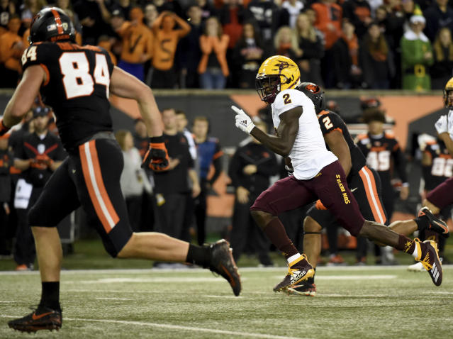 Arizona State wide receiver Brandon Aiyuk runs a punt back for a touchdown as Oregon State tight end Teagan Quitoriano gives chase during the first half of an NCAA college football game in Corvallis, Ore., Saturday, Nov. 16, 2019. (AP Photo/Steve Dykes)