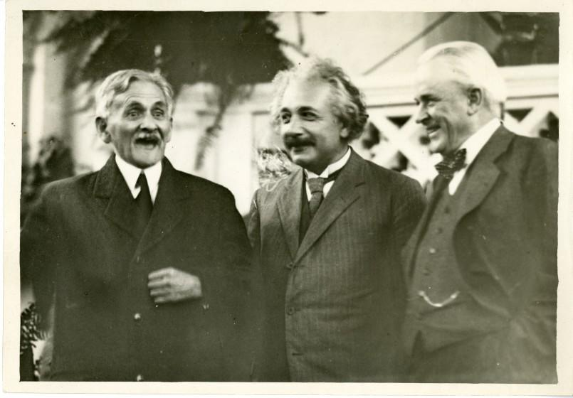 Robert A. Millikan, right, shares a light moment on the Caltech campus in 1931 with physicists Albert Einstein, center, and A.A. Michelson, left.