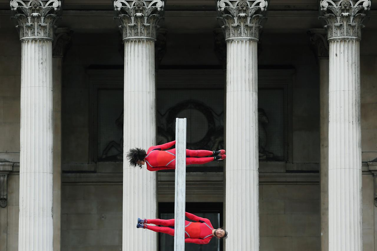LONDON, ENGLAND - JULY 15:  Dancers perform a routine in front of the National Gallery in Trafalgar Square as part of the 'One Extraordinary Day' performances on July 15, 2012 in London, England. The dancers are part of American choreographer Elizabeth Streb's 'Extreem Action' dance group which will perform around London for one day only and form part of the Cultural Olympiad.  (Photo by Dan Kitwood/Getty Images)