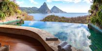 """<p>You'll never tire of gazing at St. Lucia's gorgeous <a rel=""""nofollow noopener"""" href=""""https://www.bestproducts.com/fun-things-to-do/g2713/most-beautiful-places-in-the-world/"""" target=""""_blank"""" data-ylk=""""slk:Piton Mountains"""" class=""""link rapid-noclick-resp"""">Piton Mountains</a>. Luckily, these twin peaks are visible from all over the island, including from the comfort of your room in high-end resorts like <a rel=""""nofollow noopener"""" href=""""https://www.tripadvisor.com/Hotel_Review-g147345-d623374-Reviews-Jade_Mountain_Resort-Soufriere_Soufriere_Quarter_St_Lucia.html"""" target=""""_blank"""" data-ylk=""""slk:Jade Mountain"""" class=""""link rapid-noclick-resp"""">Jade Mountain</a>. St. Lucia also has a lush rainforest - hike or bike amid mango and guava trees to natural hot springs, and in Castries, shop for spices, tropical fruit, and crafts in the market. </p>"""
