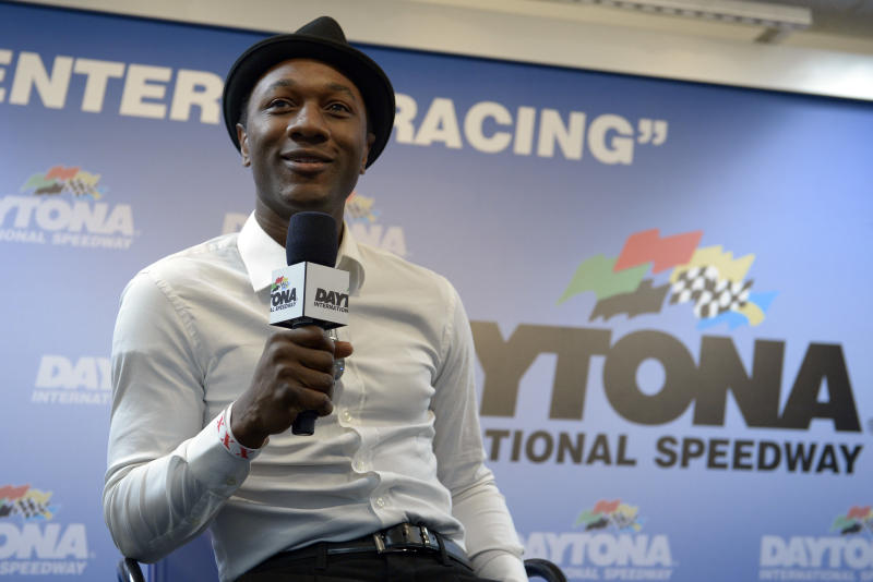 Singer Aloe Blacc answers a question during a news conference before the NASCAR Daytona 500 Sprint Cup series auto race at Daytona International Speedway in Daytona Beach, Fla., Sunday, Feb. 23, 2014. (AP Photo/Phelan M. Ebenhack)
