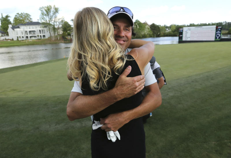 April 16, 2017, Duluth: Stephen Ames, Canada, gets a hug from his girlfriend Kelly Norcott on the 18th green winning the Mitsubishi Electric Classic at TPC Sugarloaf at 15-under par for a four stroke victory over second place finisher Bernhard Langer on Sunday, April 16, 2017, in Duluth, Ga. (Curtis ComptonAtlanta Journal-Constitution via AP)