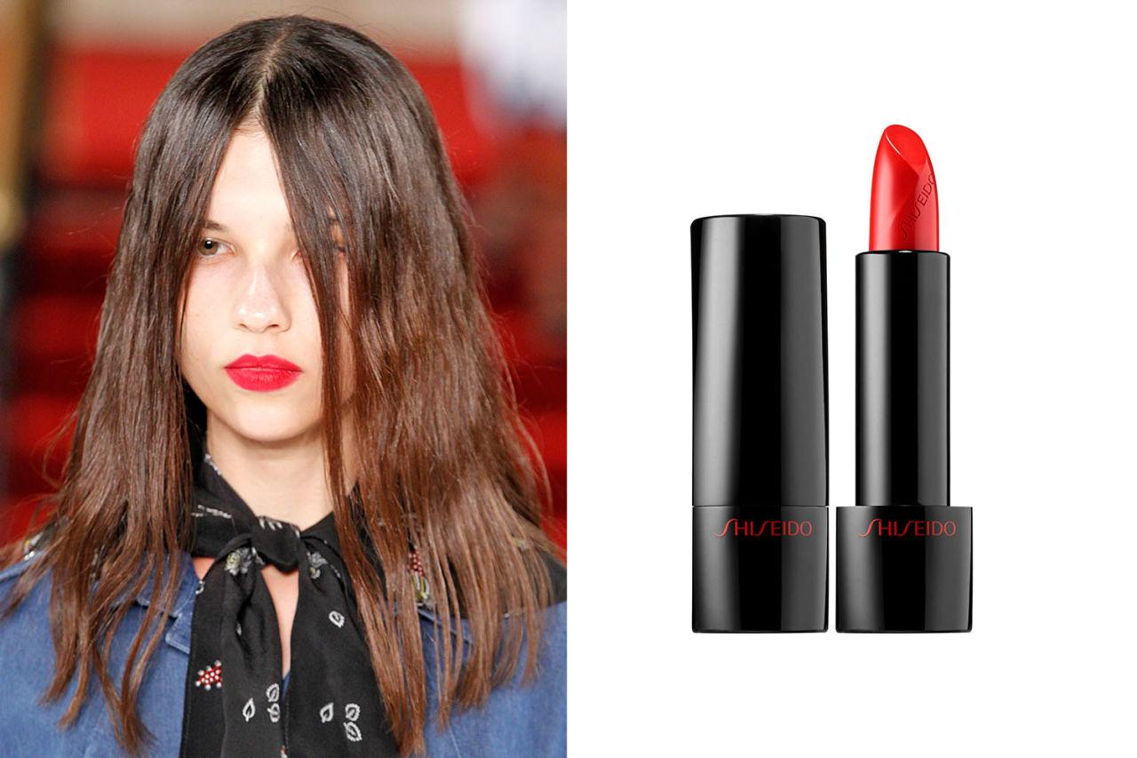 "<p>To tone down deep red lips with a glossy finish, the beauty gurus at Creatures of the Wind blotted a cherry red lip shade with a fuchsia<span></span> blush over and over again to achieve an electric matte effect. They used Nars' Velvet Matte Lip Pencil in 'Dragon Girl,' but for a range of classic reds, check out Shiseido's Rouge Rouge lipsticks, too. </p><p><strong>For a similar look, try</strong><span> <strong>Shiseido Rouge Rouge Lipstick in 'Poppy,' $28; <a rel=""nofollow"" rel=""nofollow"" href=""http://www.sephora.com/rouge-rouge-lipstick-P411023?skuId=1864511"">sephora.com</a>.</strong></span></p>"