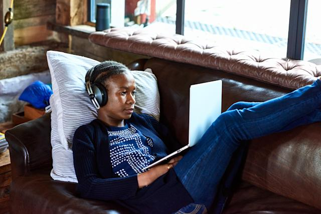 Podcasts can keep you company and ward off solitude when working from home. (Getty)