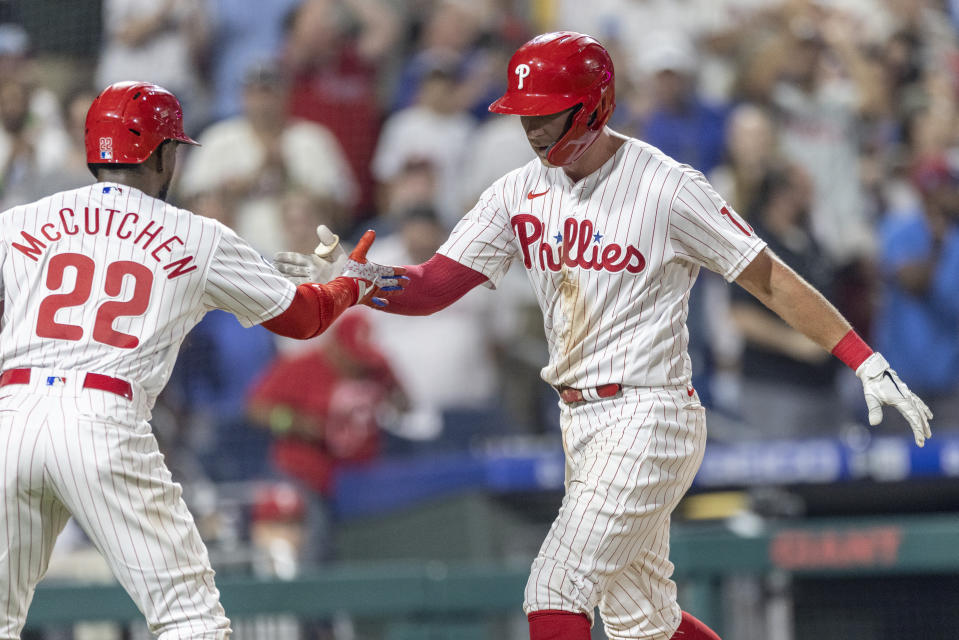 Philadelphia Phillies' Rhys Hoskins (17) celebrates with Andrew McCutchen (22) after hitting a three-run home run during the sixth inning of a baseball game against the Washington Nationals, Monday, July 26, 2021, in Philadelphia. (AP Photo/Laurence Kesterson)