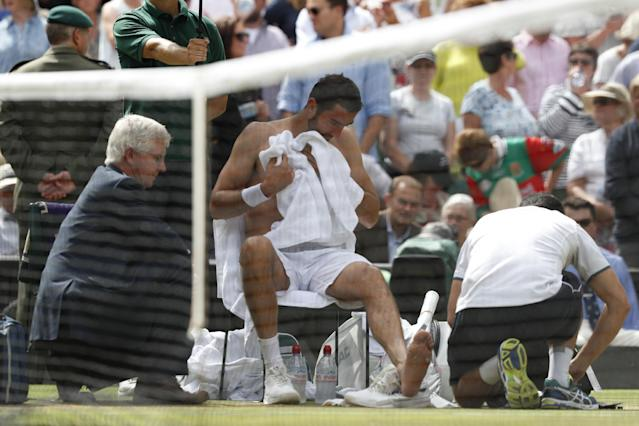 Cilic gets treatment on court(AFP).