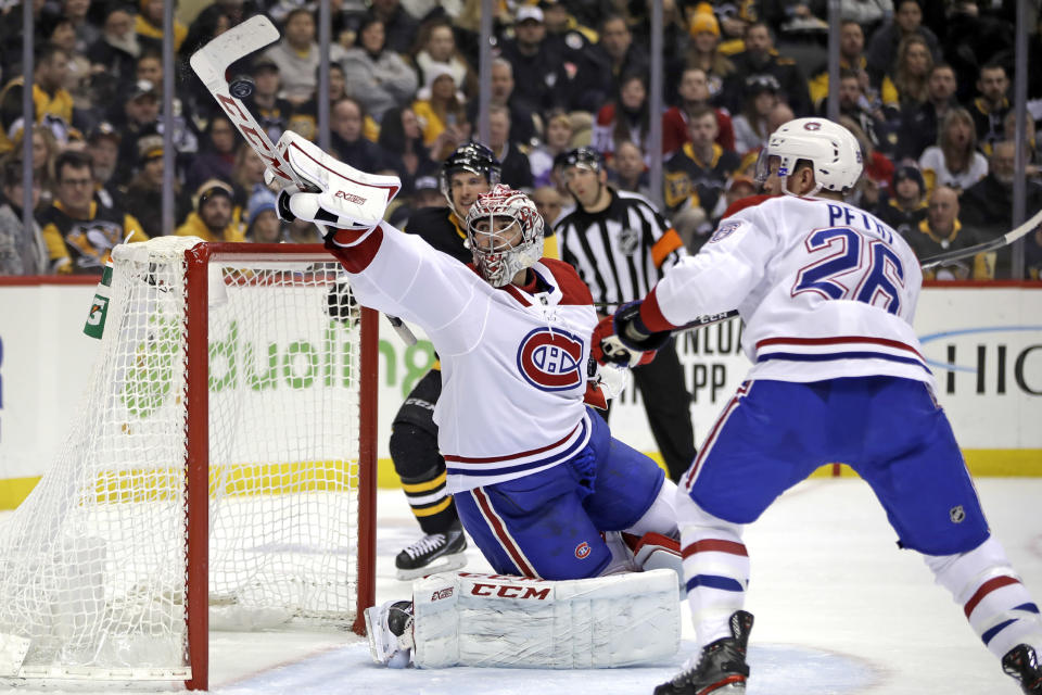 Montreal Canadiens goaltender Carey Price deflects a shot with his stick during the second period of the team's NHL hockey game against the Pittsburgh Penguins in Pittsburgh, Friday, Feb. 14, 2020. (AP Photo/Gene J. Puskar)