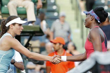 Mar 26, 2018; Key Biscayne, FL, USA; Venus Williams of the United States (R) shakes hands with Johanna Konta of Great Britain (L) after their match on day seven of the Miami Open at Tennis Center at Crandon Park. Williams won 5-7, 6-1, 6-2. Mandatory Credit: Geoff Burke-USA TODAY Sports