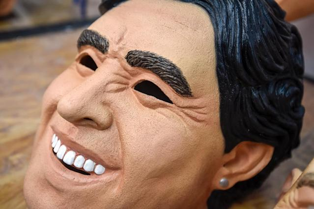 View of a latex mask of former football star Diego Maradona at a factory in Jiutepec, Morelos State, Mexico (AFP Photo/ALFREDO ESTRELLA)