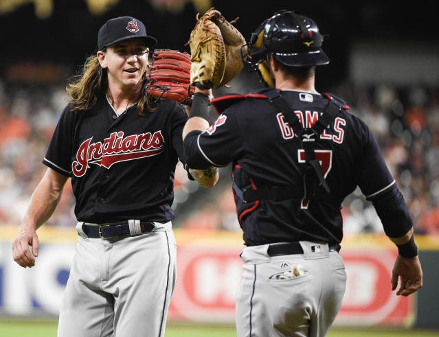 Cleveland Indians starting pitcher Mike Clevinger, left, and catcher Yan Gomes celebrate after a double play to end the first inning of a baseball game against the Houston Astros, Friday, May 18, 2018, in Houston. (AP Photo/Eric Christian Smith)