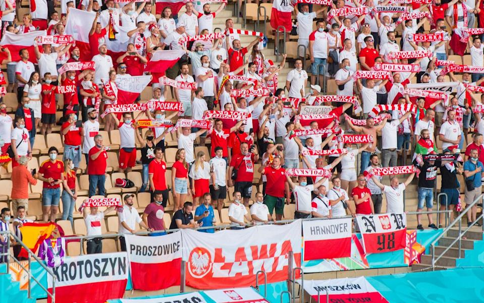 Poland fans urge their team on - GETTY IMAGES