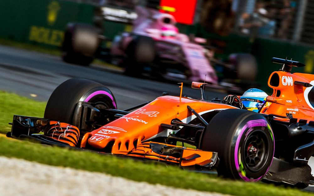 Fernando Alonso (foreground) was attempting to fight off the attentions of Force India's Esteban Ocon (background) when his car failed at the Australian Grand Prix in Melbourne - Credit: SRDJAN SUKI/EPA
