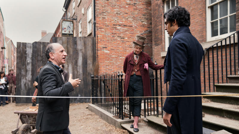 Armando Iannucci, Peter Capaldi and Dev Patel on set of 'The Personal History of David Copperfield'. (Credit: Lionsgate)