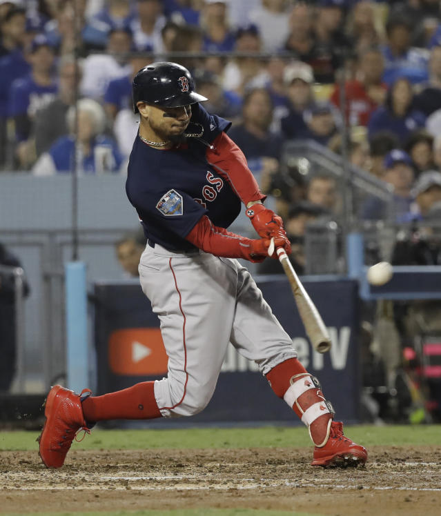 Boston Red Sox's Mookie Betts hits a solo home run against Los Angeles Dodgers' Clayton Kershaw during the sixth inning in Game 5 of the World Series baseball game on Sunday, Oct. 28, 2018, in Los Angeles. (AP Photo/David J. Phillip)