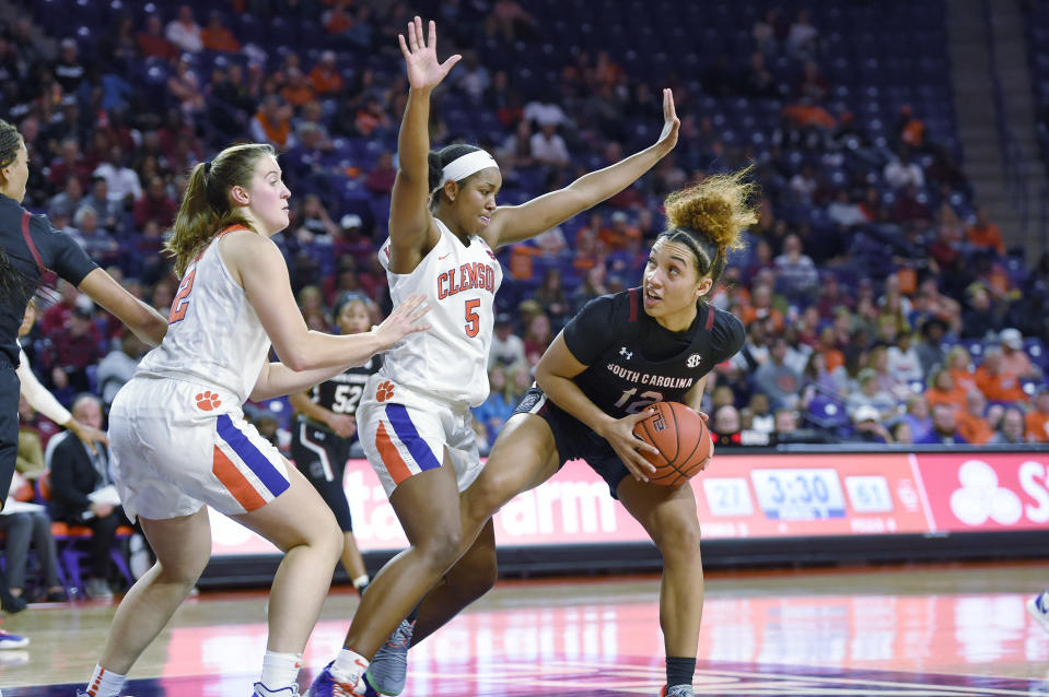South Carolina's Brea Beal, right, works under the basket while defended by Clemson's Amari Robinson, center, and Hannah Hanks during the second half of an NCAA college basketball game Sunday, Nov. 24, 2019, in Clemson, S.C. (AP Photo/Richard Shiro)