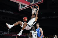 Germany's Johannes Thiemann dunks the ball during men's basketball preliminary round game against Italy at the 2020 Summer Olympics, Sunday, July 25, 2021, in Saitama, Japan. (AP Photo/Charlie Neibergall)