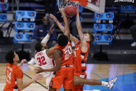 Houston forward Reggie Chaney (32) has his shot blocked by Syracuse forward Marek Dolezaj (21) as Robert Braswell (20) defends in the first half of a Sweet 16 game in the NCAA men's college basketball tournament at Hinkle Fieldhouse in Indianapolis, Saturday, March 27, 2021. (AP Photo/Michael Conroy)