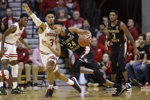 Florida State guard Devin Vassell (24) drives on Indiana forward Justin Smith (3) during the first half of an NCAA college basketball game Tuesday, Dec. 3, 2019, in Bloomington, Ind. (AP Photo/Darron Cummings)