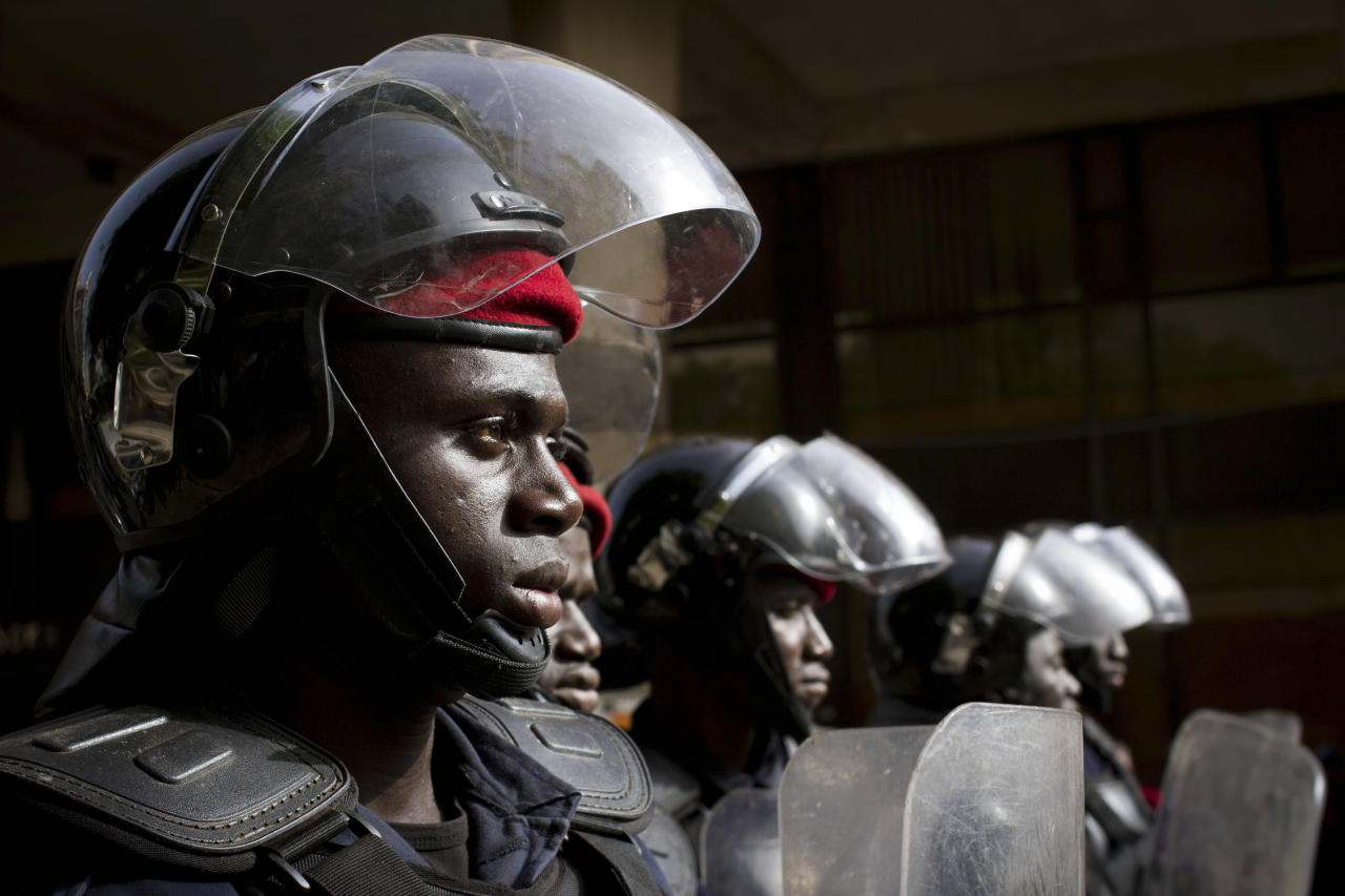 Police in riot gear stand guard at the site of an unauthorized anti-government protest in central Dakar, Senegal Wednesday, Feb. 22, 2012. Thousands of supporters turned out to see Senegalese President Abdoulaye Wade Wednesday as he held rallies in the downtrodden Pikine and Guediawaye suburbs. Daily protests have rocked the capital after the opposition vowed to render the country ungovernable if 85-year-old Wade runs for a third term in Sunday's elections.(AP Photo/Tanya Bindra)