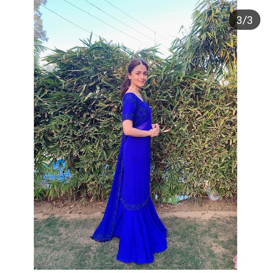 <p>The bridemaid was radiant at her BFF's wedding this month and what seems to have registered in our minds in the electric blue saree. I don't know about others but I am gettin Madhuri Dixit-meets-Sridevi vibes from this look. The Manish Malhotra saree has minimum embelishment – we love she didn't mean to steal the bride's thunder – that brought her efforless charm to the forefront. To complete the look, Alia picked a pink <em>meenakari </em>chocker neckpiece and matching <em>tikka </em>while giving a miss to earrings. </p>