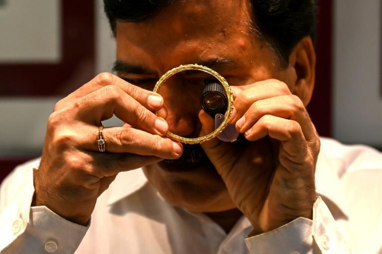 Gold holds a huge amount of financial and cultural significance in India, essential at weddings, birthdays and religious ceremonies (AFP/Punit PARANJPE)