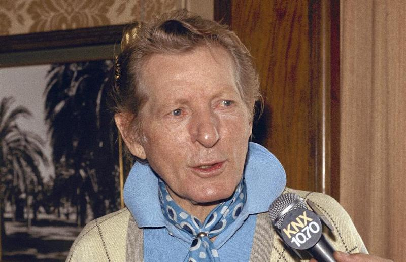 FILE - In this Sept. 27, 1983 file photo, entertainer Danny Kaye is interviewed by the media in Pasadena, Calif. In the 100th year of his birth, Dena Kaye is determined to help a new generation discover the genius, and the generosity, of her father, who died in 1987 at age 74. Danny Kaye is now on Facebook with an official page. His official Website has been relaunched with plenty of multimedia. The Library of Congress unveiled its new Danny and Sylvia Fine Archive, where countless documents, including video, audio and photographs from Dena's parents' own collection, are available for examination on the Internet. (AP Photo/Wally Fong)