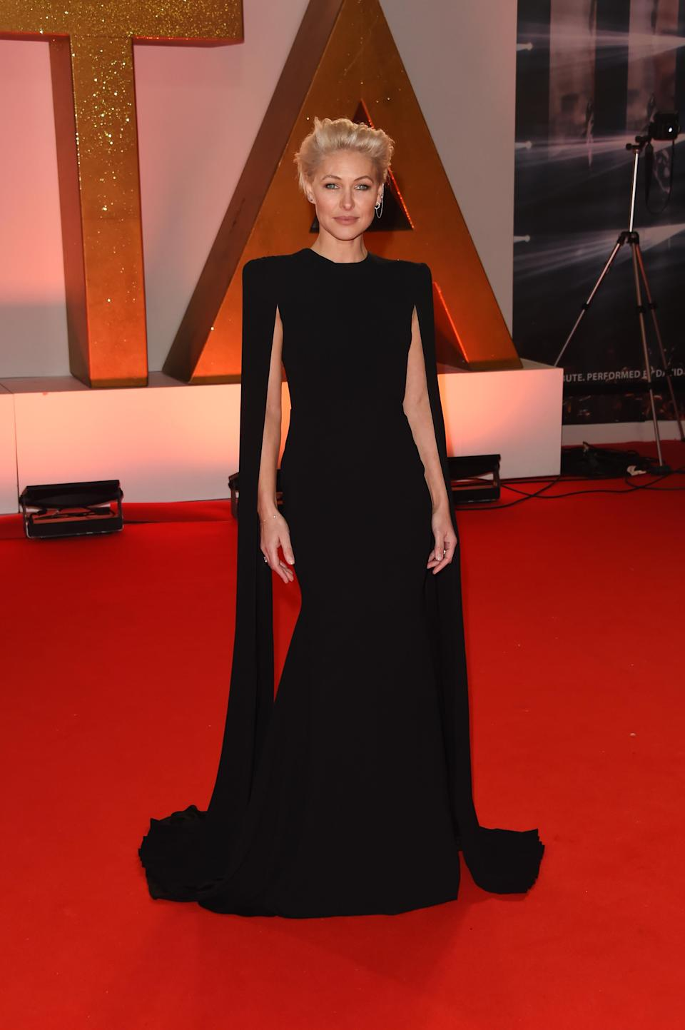 <p>On January 22, Emma Willis donned a chic caped dress for the 2019 National Television Awards. <em>[Photo: Getty]</em> </p>