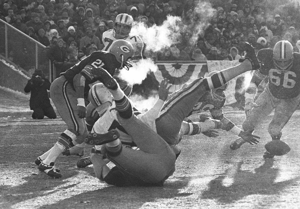 FILE - In this Dec. 31, 1967, file photo, players spill in all directions as a fumble occurs in the third period of the National Football League Championship game between the Dallas Cowboys and the Green Bay Packers at Lambeau Field in Green Bay, Wisc. Dallas quarterback Don Meredith (white jersey, #17) fumbles and Herb Adderley of the Packers (#26, partially hidden) reaches to recover it. Played in sub-zero temperatures, the contest was later dubbed, 'The Ice Bowl.' (AP Photo/File)