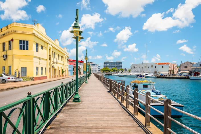 The wooden promenade at the waterfront of Bridgetown in Barbados. (Photo: Getty)