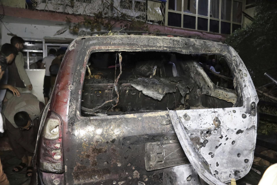 """A destroyed vehicle is seen inside a house after a U.S. drone strike in Kabul, Afghanistan, Sunday, Aug. 29, 2021. A U.S. drone strike destroyed a vehicle carrying """"multiple suicide bombers"""" from Afghanistan's Islamic State affiliate on Sunday before they could attack the ongoing military evacuation at Kabul's international airport, American officials said. (AP Photo/Khwaja Tawfiq Sediqi)"""